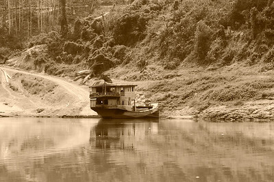 northern Laos A liveaboard boat on the Mekong in northern Laos.
