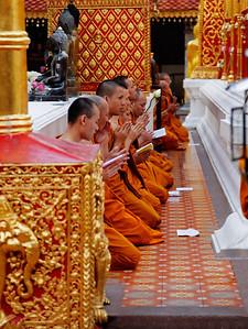 Chiang Mai, Thailand Buddhist monks praying and chanting at Wat Phrathat Doi Suthep.