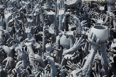 Chiang Rai Province,Thailand A pool of reaching hands near the bridge entering Wat Rong Khun (White Temple) in Chiang Rai Province in northern
