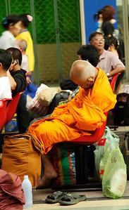 Bangkok, Thailand Sleeping Monk at train station.