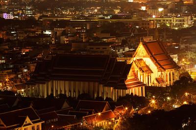Bangkok, Thailand Wat Suthat Thep Wararam at night.