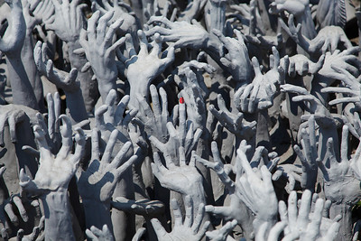 Chiang Rai Province,Thailand A pool of reaching hands near the bridge entering Wat Rong Khun (White Temple) in Chiang Rai Province in northern Thailand.
