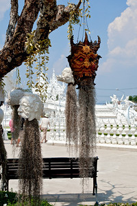 Chiang Rai Province,Thailand Hanging heads near the entrance to Wat Rong Khun (White Temple) in Chiang Rai Province in northern Thailand.