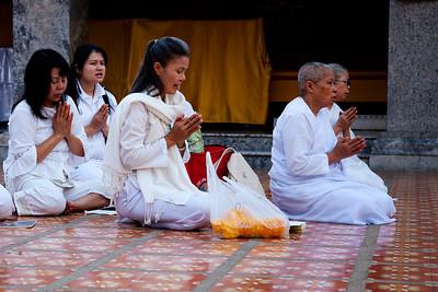 Chiang Mai, Thailand Buddhist nuns in white robes praying at Wat Phrathat Doi Suthep.