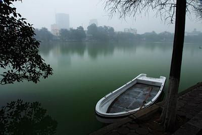 Hanoi, Vietnam A small boat on Hoan Kiem Lake in the Old Quarter, Hanoi.