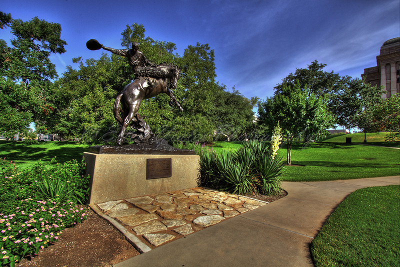 """<b>TEXAS COWBOY</b> Erected 1925.   The bronze statue was presented to the State of Texas, """"native home of the cowboy."""" by the notable American sculptor Constance Whitney Warren. It represents the artist's portrayal of a typical Texas cowboy riding a rearing horse, and is a tribute to the """"rough and romantic riders of the range.""""  This photo was taken on August 22, 2009"""