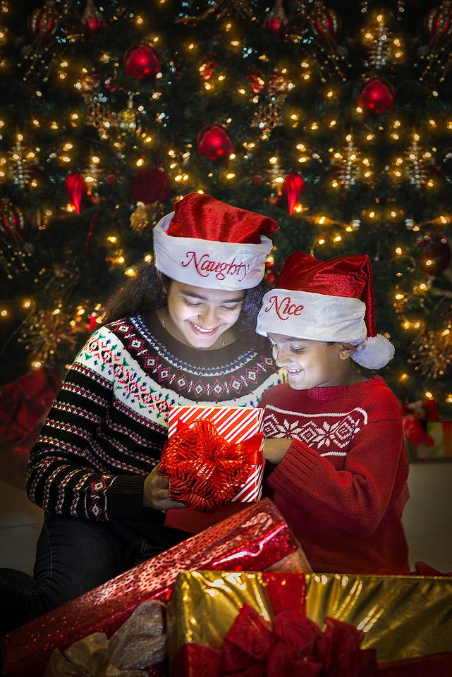 Ritika and Rohan (Santa's kids) enjoying opening there Christmas gifts