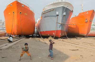 Playing cricket in the shipyard