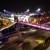 Pedestrian Bridge with Five Star Stadium in background at night with lights