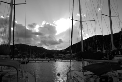 As the sun sets after another beautiful afternoon in Tortola the yachts bid farewell to the sun as it disappears behind the clouds.   East End, Tortola, British Virgin Islands