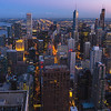 Chicago skyline sunset (south-side skyscrapers) as seen from John Hancock Center's 94th floor