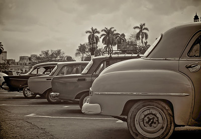 Chevs & Lada outside national Capitol, Havana