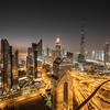 Night view of Dubai Downtown district.
