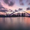 Long exposure of sunrise colors over Dubai Downtown.