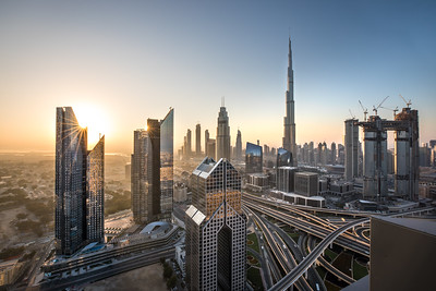 Sunrise colors over Dubai Downtown district.