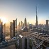 Sunrise colors over Dubai Downtown district.