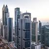 View of Dubai International Financial District at sunrise.