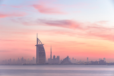 Dubai skyline lighted with beautiful sunrise colors.