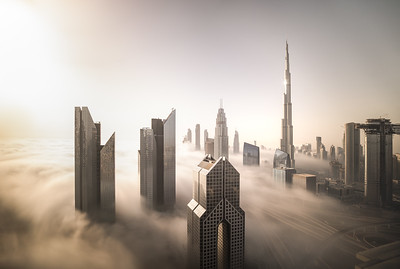 Dubai Downtown skyline on a foggy winter day.