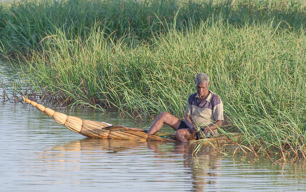 Fisherman on a traditional wooden punt