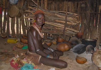 Mursi tribeswoman inside her hut