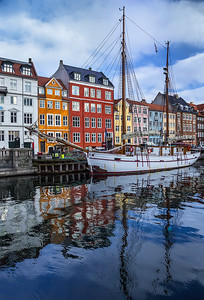 Denmark, Copenhagen: An old ketch-rigged sailboat sits on the edge of the well-known Nyhavn Canal in Copenhagen.