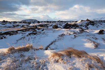 Iceland, Snæfellsnes: Lava Fields at Búðakirkja Church on the Snæfellsnes peninsula.