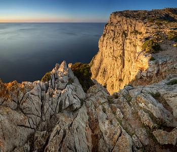 Mallorca, Islas Baleares, Spain: Cap de Formentor at sunset just southwest of the lighthouse.
