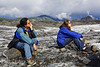 """I thought these two were contemplating the glacier in front of them. Thinking deep thoughts, such as; how old is the Matanuska Glacier, how fast does in move, has it receded rather than grown, etc etc etc. Then I found out they were waiting for the ice under them to move, and were using their butts as """"movement barometers!"""" So much for deep thoughts!"""
