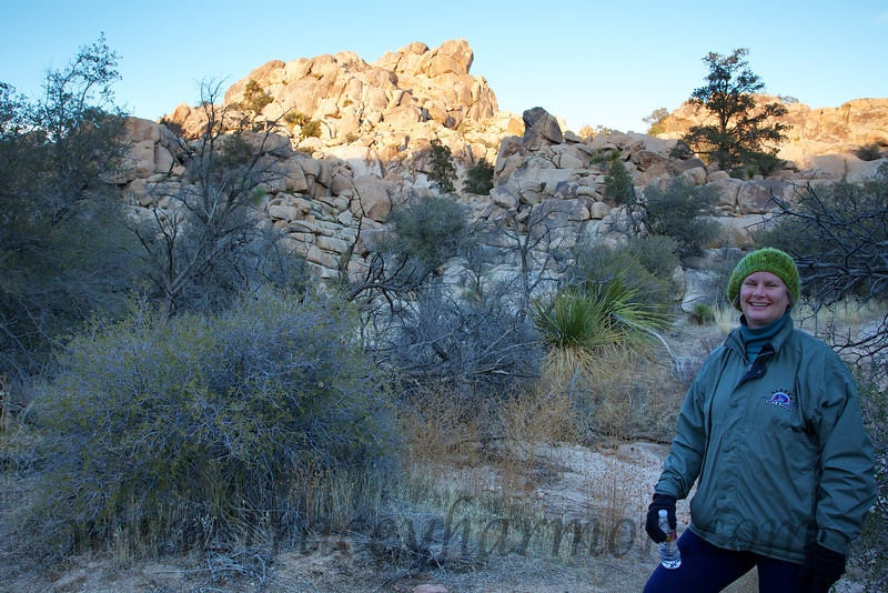 Kim, bundled up against the mid-winter desert cold, as she completes a late afternoon day hike in California's Joshua Tree National Park.