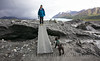 Major patiently waiting while his mom, Kim, crosses a bridge over glacier run-off at the toe of the Matanuska Glacier.