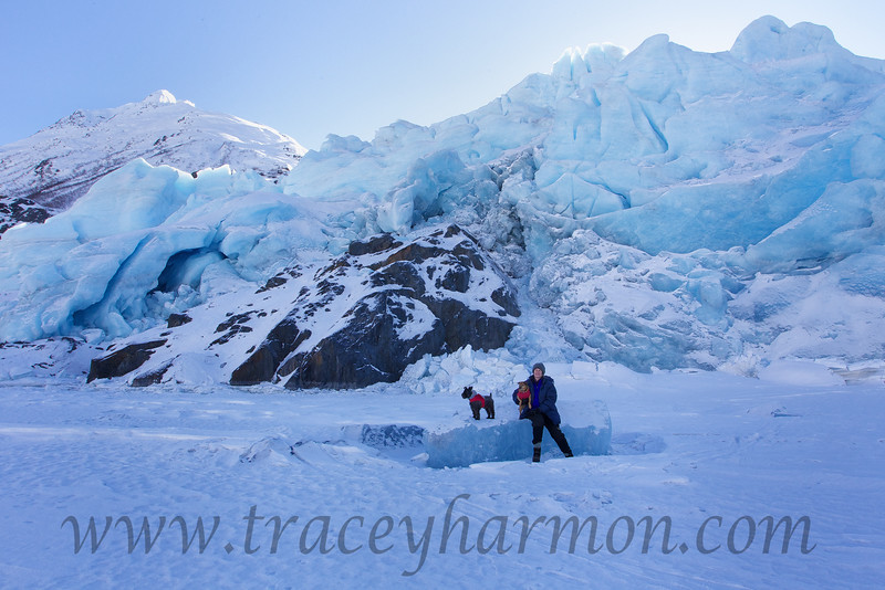 Kim, and her boys (Curtis and Major), sitting on an glacial ice block frozen to the surface of Portage Lake, Alaska.