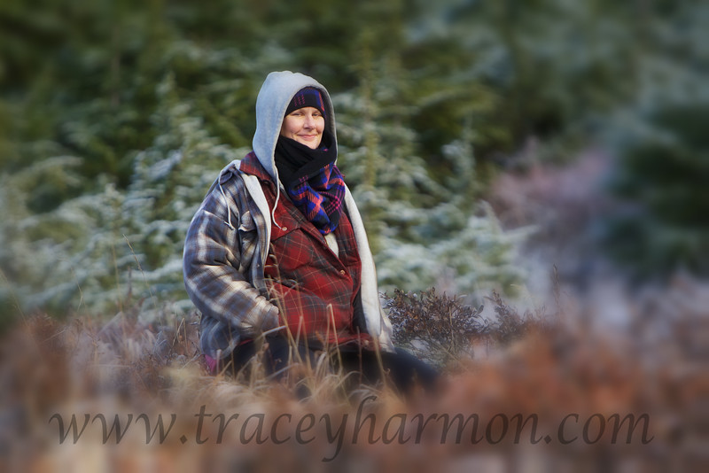 Kim waiting on me while I photograph rutting bull Moose in Chugach State Park outside of Anchorage, Alaska.