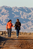 Kim and our son-in-law, Alejandro Cervantes, share a bag of chips in the waning sun as they hike through a portion of the Sonny Bono Salton Sea National Wildlife Refuge in southern California.