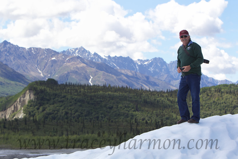 Steve Kemp standing atop the Matanuska Glacier with the Chugach Range behind him.