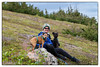 Kim and her boys (Curtis the mix and Major the Schnauzer) taking a break from hiking Powerline Trail in the Chugach Mountains above Anchorage, Alaska.
