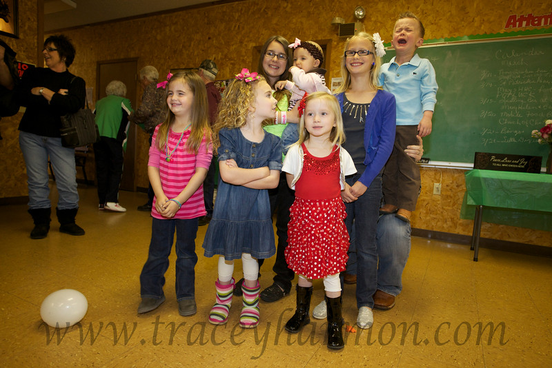 Okay, Mom and Dad's great-grandkids are in one place at one time, though SOME are not happy about it!
