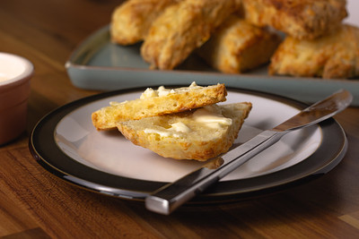 Cheese scones with butter close up