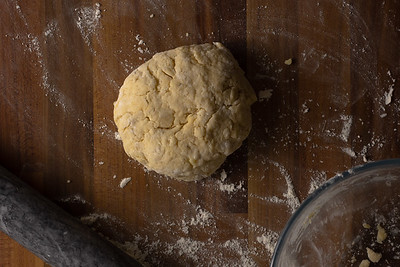 Cheese scone dough on a wooden surface