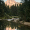 Evening sun on Half Dome reflected in the Merced River in Yosemite National Park, California