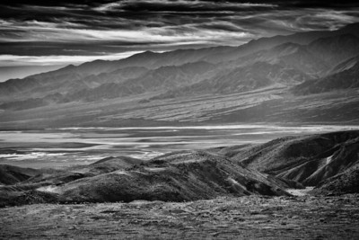 Texture and contrast in the sand, mountains and clouds. Death Valley N.P.