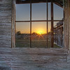 Sunset through the Ghost Town's Window