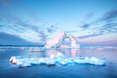Photogenic and intricate iceberg in sunrise light.