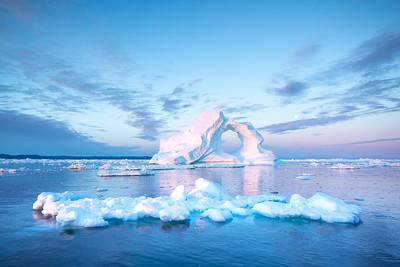 Photogenic and intricate iceberg in sunrise light.