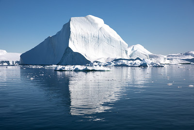 Massive ice berg in bright daylight.