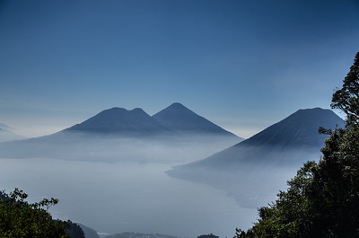 San Pedro, Tollman & Atitlan volcano rise through mist