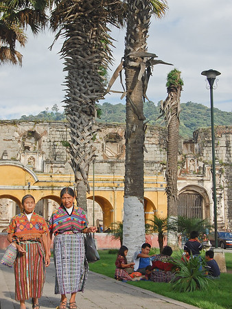 Maya women walking in Antigua's main square