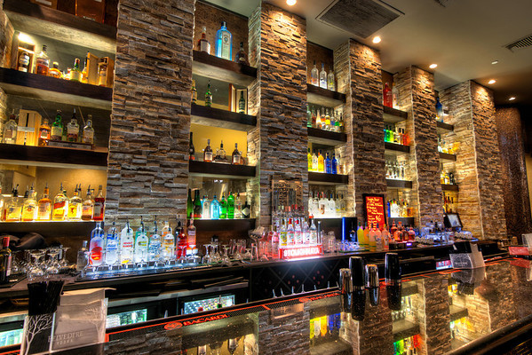 """Bottles of Light<br /> This is the """"beverage area"""" of Taisho"""", a Japanese restaurant in Sugar Land Town Center. This type of lighting is great for HDR photos, as it captures the bright and dark areas equally well."""