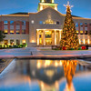 Reflecting on Christmas<br /> Like  many photographers, reflections have a special attraction that can make a photo come alive. But since I don't live close to a lake, pond or other natural attraction, I have to keep a keen eye open for rare opportunities. The reflection pool at the local Town Center provided a great chance for this Christmas photo.