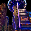 Bayou Place Sign<br /> Talk about a unique sign! The Bayou Place sign looks more like a tower or maybe a space alien than a traditional sign. But it seems to fit right in with the theater district in downtown Houston. Best viewed at night, this purple and blue neon sign with the round top makes it a unique landmark in that part of town.